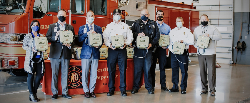 Noman Regional Health System President and CEO Richie Splitt, EMSSTAT Manager Eddie Sims, and Emergency Services Manager Kyle Hurley present new AEDs to the Norman Fire Department.