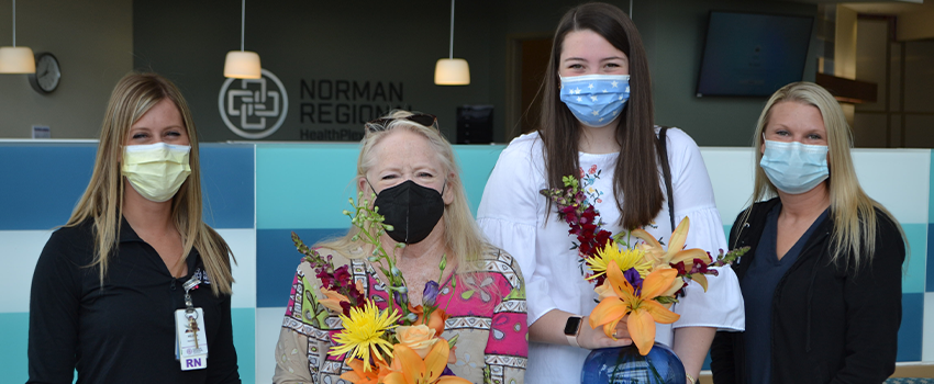 Emergency nurse Melissa Murchison, survivor Dee Holcomb, OU student Caroline Keogh, and Sara McMillan, Norman Regional's clinical manager of Centers of Excellence, pose for a photo during their reunion at Norman Regional HealthPlex on April 12.