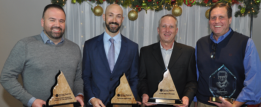 Lawrence Carter, MD, Dustin Tedesco, MD, Darren Gose, APRN-CRNA, and Patrick Livingston, DO, stand with their provider of the year awards.